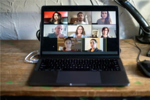 computer screen of team mates holding a virtual conference