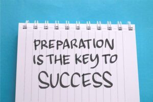 Lined notebook with the words 'Preparation is the key to success' written on the page.