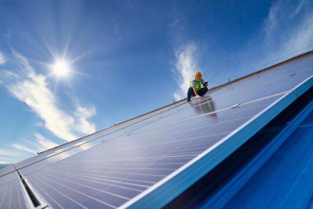 an engineer working on solar panels on a solar farm