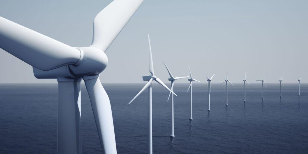 a wind farm - wind turbines out at sea.